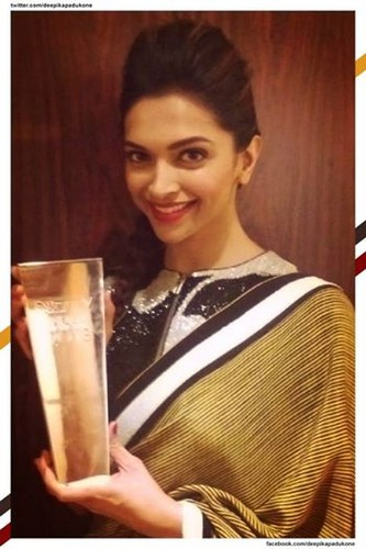 Deepika Padukone wallpaper probably with alcohol called ndtv award 2014