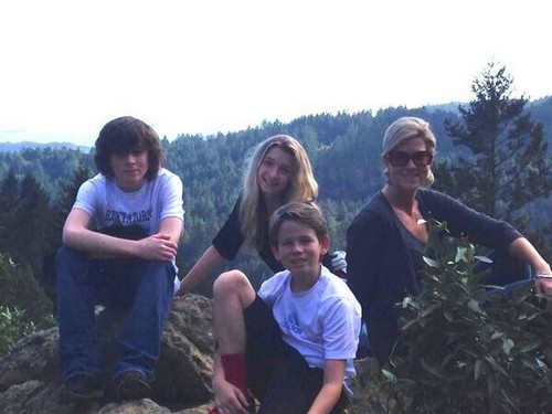 Chandler Riggs Hintergrund probably with a grainfield, a sitka spruce, and a laubdecke, mulch entitled Chandler with Hana, his mom and brother during Spring break