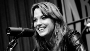 Lzzy smiling at the studio