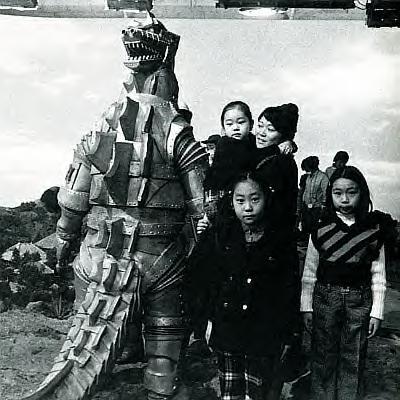 Godzilla wallpaper containing a green beret, a rifleman, and a navy segel titled Mechagodzilla plays with kids