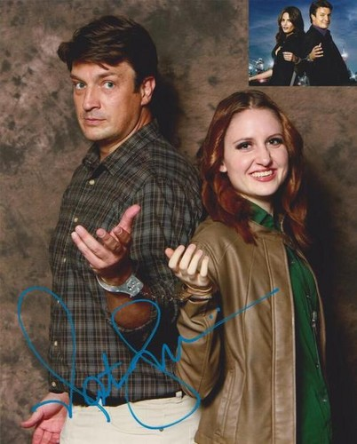 Nathan Fillion & Stana Katic wallpaper probably with a box coat, an outerwear, and a strada, via titled Nathan and a fan(May,2014)