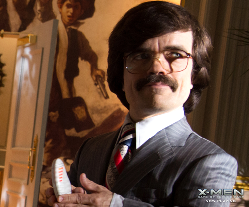 Peter Dinklage Hintergrund with a business suit and a suit entitled Peter Dinklage as Bolivar Trask in X-Men