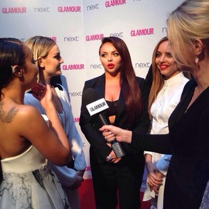 The girls being interviewed to the Glamour Awards