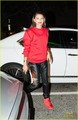 Zendaya rocks a red suit while arriving at the El Rey Theater in Los Angeles on Thursday night (May  - zendaya-coleman photo