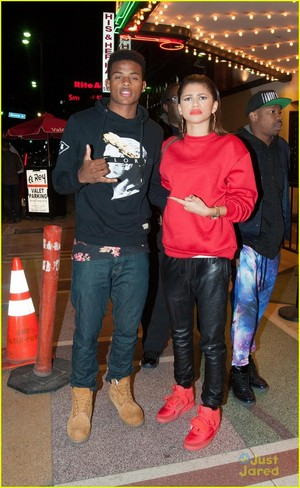 Zendaya rocks a red suit while arriving at the El Rey Theater in Los Angeles on Thursday night (May