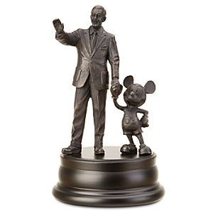 A Statue Figurine Of Walt Disney And Mickey Mouse