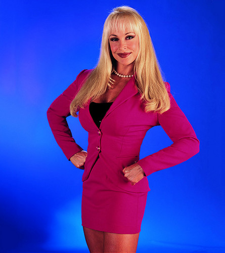 Former WWE Diva... Debra wolpeyper containing tights, a leotard, and a Playsuit called All Business Beauty - WWE.COM