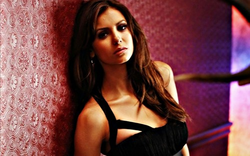 Nina Dobrev wallpaper possibly containing attractiveness, a bustier, and tights titled Amazing Wallpaper