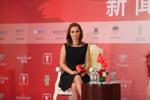 Natalie Portman wallpaper probably containing a sign called Attending a press conference at Crowne Plaza Hotel during the 17th Shanghai International Film Festi