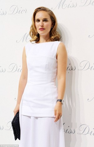 Attending the Miss Dior exhibition at Shanghai Urban Sculpture Center in Shanghai, China (06/19/14)