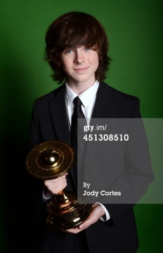 Chandler Riggs Hintergrund with a business suit entitled Chandler Saturn Awards