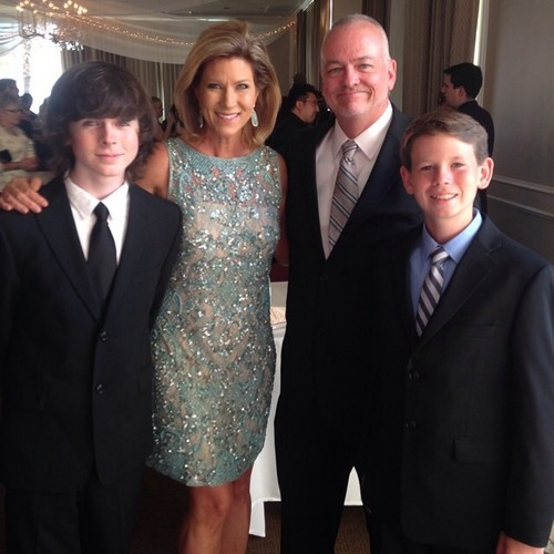Chandler Riggs Hintergrund with a business suit, a suit, and a dress suit called Chandler with his family at the Saturn Awards