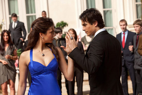 Stelena vs Delena پیپر وال probably with a business suit titled Damon n Elena