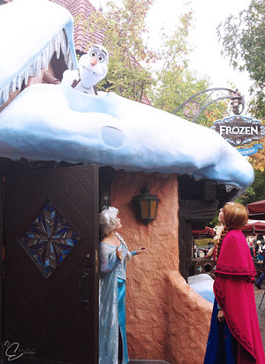 Elsa and Anna checking up on Olaf