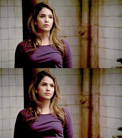 Malia Tate achtergrond with a cocktail dress and a portrait entitled Love her in that purple top, boven