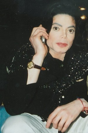 Michael Talking On His Cell Phone
