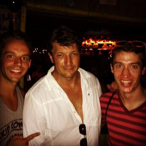 Nathan Fillion wallpaper possibly containing a diner, a fire, and a birreria, brasserie titled Nathan and fans(July,2014)