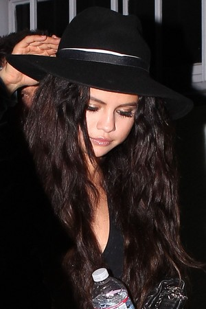 Selena leaving after a brief visit to a recording studio (June 23)