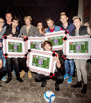 The boys receiving their double-platinum plate for 'Midnight Memories' backstage in San Siro.