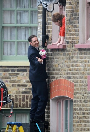 Tom Hardy climbs drainpipe to steal kiss and 'propose' to Emily Browning as they film Krays biopic
