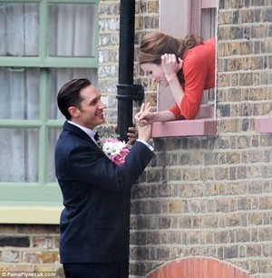 Tom Hardy climbs drainpipe to steal Kiss and 'propose' to Emily Browning