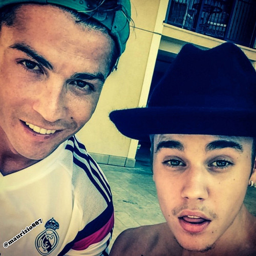 Soccer wallpaper probably with a fedora entitled  cristiano ronaldo, justin bieber .2014