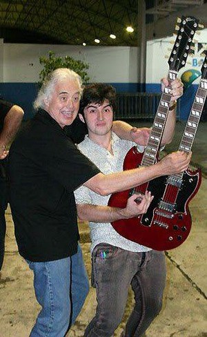 Jimmy and his son James goofing round with the double neck