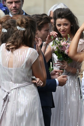 Louis Tomlinson wallpaper containing a bridesmaid entitled Louis and Eleanor at Johannah and Dan's wedding. 20/07/14