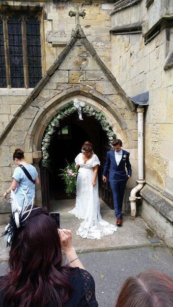 Louis with his mom at her wedding. 20/07/14