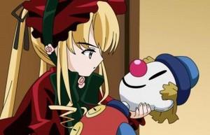Shinku holds a puppet