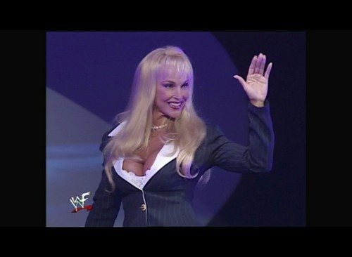 Former WWE Diva... Debra achtergrond possibly containing a well dressed person, a business suit, and a concert titled Smackdown! 10.13.99
