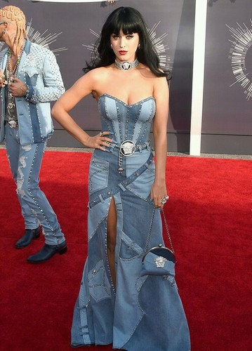 Katy Perry karatasi la kupamba ukuta probably with a chajio, chakula cha jioni dress, a strapless, and a kanzu, gown called VMAs 2014