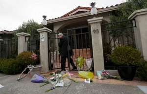 A man who did not give his name exits the front gate outside of the Home of Robin Williams