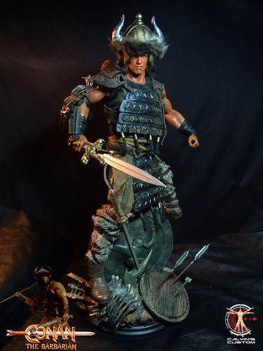 Arnold Schwarzenegger Hintergrund probably with a rifleman, a green beret, and a surcoat, wappenrock called Calvin's Custom One Sixth scale Arnold Schwarzenegger Conan the Barbarian figure