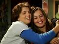 Casey and Derek hug