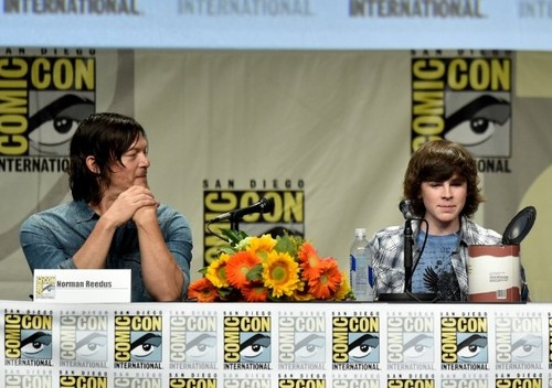 Chandler Riggs Hintergrund containing a newspaper called Chandler and Norman at Comic con 2014