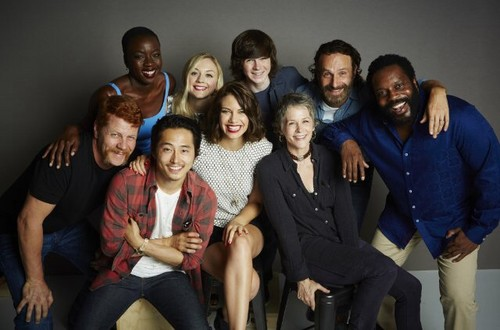 Chandler Riggs Hintergrund containing a business suit and a well dressed person called Chandler and the cast of TWD at Comic Con 2014