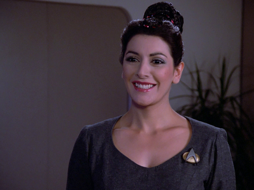Star Trek-The Next Generation wallpaper probably containing an outerwear, a blouse, and a portrait called Deanna Troi