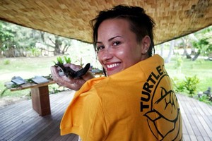 Demi became a Godparent of a черепаха at the Meridien Resort in Bora Bora - August 2014