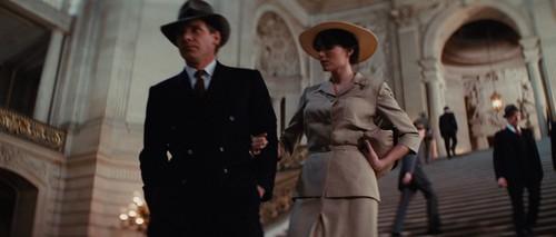 ویژن ٹیلی & Movie Couples پیپر وال with a business suit, a street, and a well dressed person titled Indy and Marion