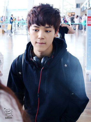 Jimin (BTS) wallpaper probably containing a hood, a sweatshirt, and a leisure wear entitled Jimin at the airport
