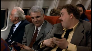 Del introducing himself to Neal on the plane