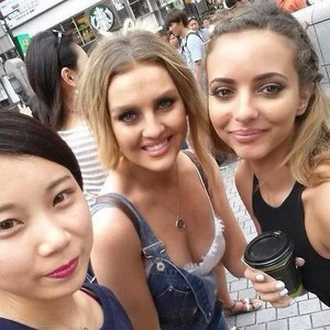 Perrie and Jade with a fan in Osaka today