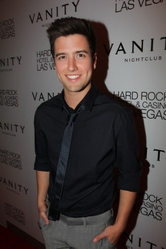 Logan Henderson wolpeyper probably with a well dressed person, a sign, and an outerwear called logan henderson :3
