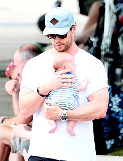 Chris holding one of his twin sons