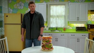 Dean with a sandwich in changing chanels