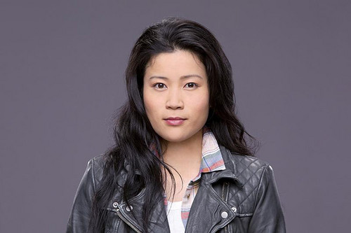 schorpioen, schorpioen, scorpion (CBS) achtergrond containing a trench jas titled Jadyn Wong as Happy Quinn