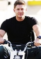 Jensen Riding a Small Motorcycle - jensen-ackles photo