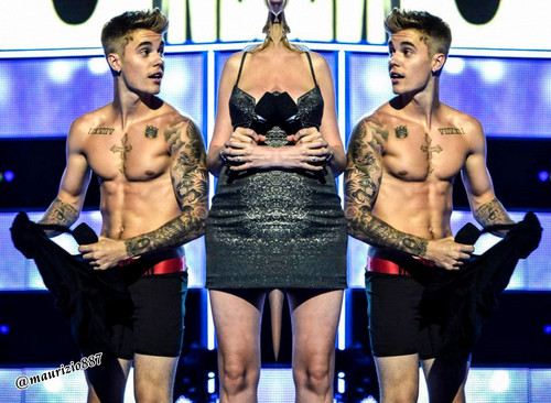 Justin Bieber wallpaper possibly containing tights, a hip boot, and a leotard entitled Justin Bieber ,strips Fashion Rocks, 2014