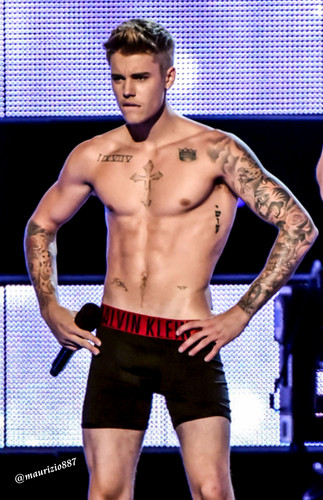 justin bieber wallpaper probably containing a hunk, a six pack, and swimming trunks called Justin Bieber ,strips Fashion Rocks, 2014
